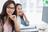 Casual female artists working at desk in office — Stock Photo