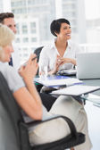 Well dressed business people in discussion at office — Stock Photo
