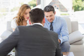 Couple in meeting with a financial adviser at home — Stock Photo