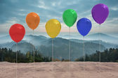Balloons in front of mountains — Stock Photo