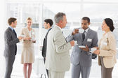 Business people chatting and drinking coffee at a conference — Stock Photo