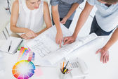 High angle view mid section of artists working on designs — Stock Photo