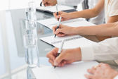 Business people taking down notes at a meeting — Stockfoto
