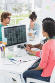 Artists working at desk in creative office — Stock Photo