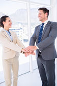 Two business colleagues joining hands together — Stock Photo