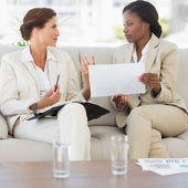 Businesswomen meeting together on the sofa — Stock Photo