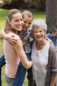 Portrait of grandmother, mother and daughter at park — Foto Stock