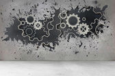 Splash on wall revealing cogs and wheels — Stockfoto