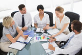 Young well dressed business people in meeting — Stock Photo