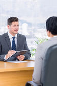 Recruiter checking the candidate during a job interview — Stock Photo