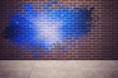 Splash on wall revealing blue light — Stock Photo