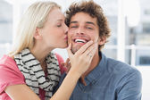 Woman kissing man on his cheek — Stock Photo