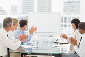 Business people clapping at blank whiteboard in conference room — Stock Photo