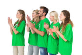 People in recycling symbol t-shirts clapping hands — Stock Photo