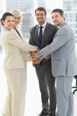 Portrait of business team joining hands together — Stock Photo