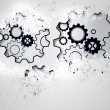 Stockfoto: Splash on wall revealing cogs and wheels