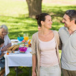 Stock Photo: Couple with family dining at outdoor table
