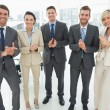 Business team clapping hands together in office — Stock Photo #39200655
