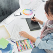 Artist drawing something on graphic tablet at office — Stok fotoğraf