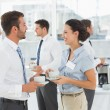 Colleagues in discussion with tea cups during break — Stock Photo #39200829