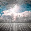 Stock Photo: Splash on wall revealing clouds