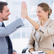 Colleagues giving high five in business meeting — Stock Photo