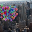 Many colourful balloons above city — Stock Photo #39201425
