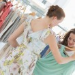 Young women shopping in clothes store — Stock Photo #39201745