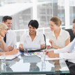 Young well dressed business people in meeting — Stock Photo #39202109
