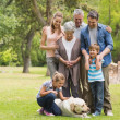 Extended family with their pet dog at park — Stock Photo #39202145