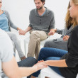 Stock Photo: Group therapy in session sitting in circle