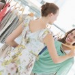 Young women shopping in clothes store — Stok fotoğraf
