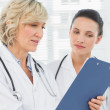 Two female doctors reading medical reports — Stock Photo #39202333