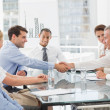 Business people making a deal at a meeting — Stock Photo