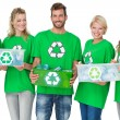 People in recycling symbol t-shirts carrying boxes — Stock Photo #39202613