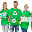 Stock Photo: People in recycling symbol t-shirts carrying boxes