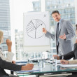 Business people in office at presentation — Stock Photo #39202749
