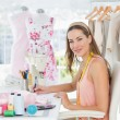 Portrait of a female fashion designer working on her designs — Stock Photo