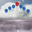 Stock Photo: Balloons above a road