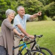 Senior couple on cycle ride in countryside — Stock Photo #39203317