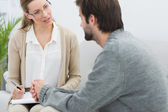 Man in meeting with a financial adviser — Stock Photo