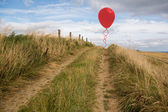 Balloon above sand dunes — Stock Photo