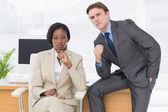 Business colleagues sitting in office — Stock Photo