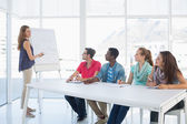 Casual business people in office at presentation — Stock Photo