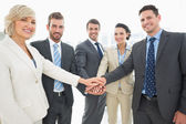 Business team joining hands together — Stock Photo