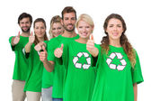 People in recycling symbol t-shirts gesturing thumbs up — Stock Photo