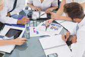 Mid section of well dressed business people in meeting — Stock Photo
