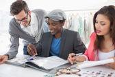 Fashion designers discussing designs — Stockfoto