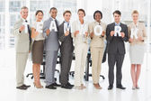 Diverse business team holding up letters spelling teamwork — Stock Photo