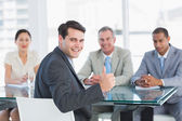 Executive gesturing thumbs up with recruiters during job intervi — Stock Photo